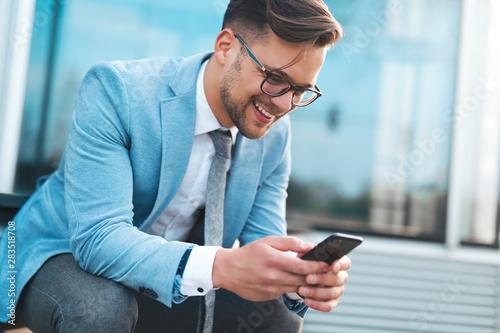 Fototapeta Businessman using phone apps obraz
