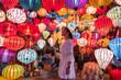 Leinwanddruck Bild - Travel woman choosing lanterns in Hoi An, Vietnam