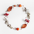 Leinwandbild Motiv Autumn composition. Wreath made of dried flowers, eucalyptus leaves, berries on gray background. Autumn, fall, thanksgiving day concept. Flat lay, top view, copy space, square