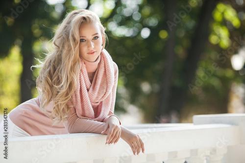 Closeup portrait of young beautiful woman. Female outdoors. Fototapet