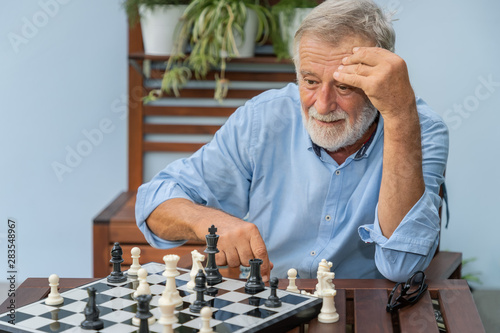 Leinwand Poster Elderly playing chess in nursing home for leisure