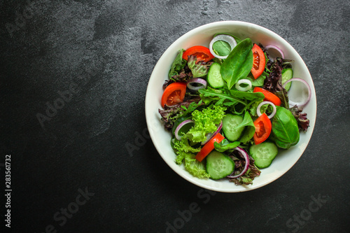 Photo  Healthy salad, leaves mix salad (mix micro greens, cucumber, tomato, onion, other ingredients)
