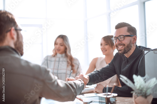 Fototapety, obrazy: smiling businessman at a working meeting in the office