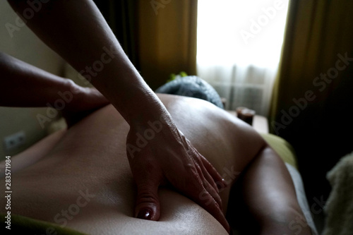 Foto op Canvas Paarden girl in a relaxing massage session