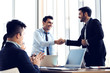 canvas print picture - Businessmen making handshake in the office, Congratulation with merger and acquisition concept