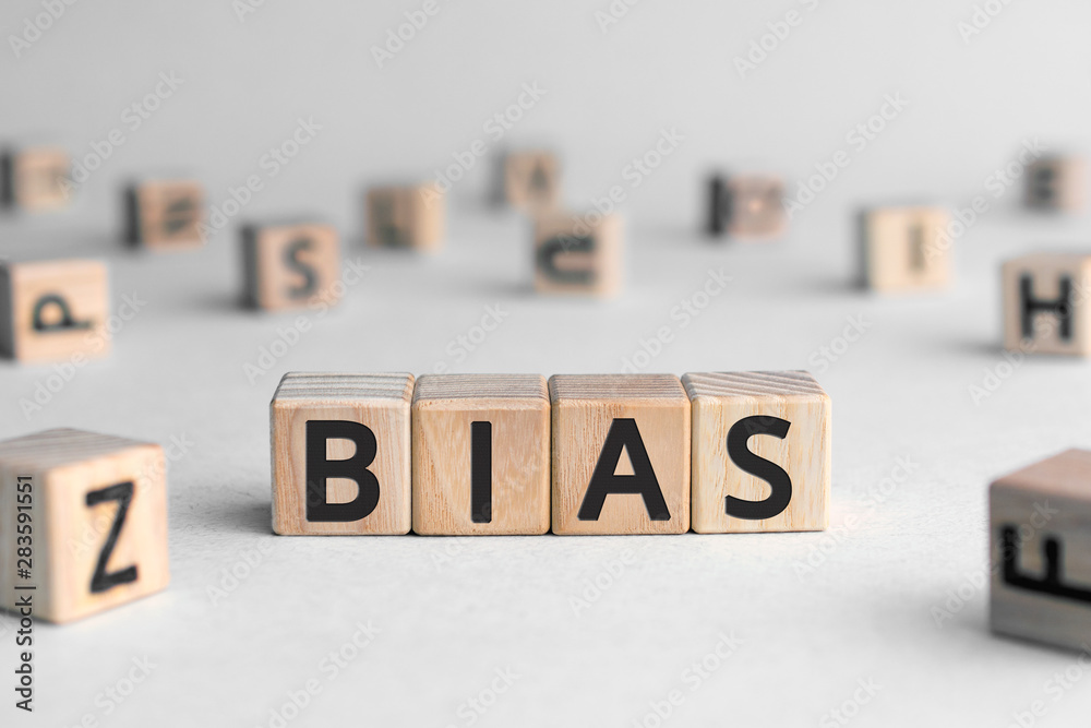 Fototapety, obrazy: Bias - word from wooden blocks with letters, personal opinions prejudice bias concept, random letters around, white  background