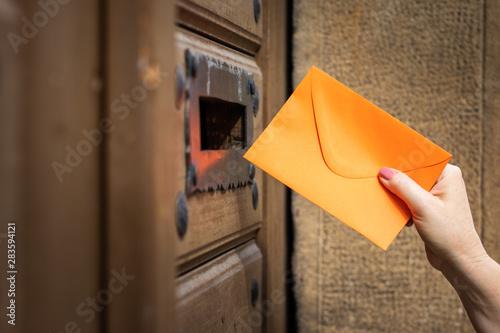 Fototapeta  Woman sending love letter