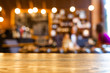 Wooden top table with blurred of coffee shop background. Mockup wooden desk for display or montage your products. Blur in coffee shop or cafe, restaurant background.