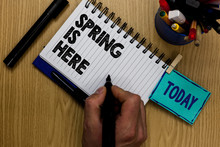 Writing Note Showing Spring Is Here. Business Photo Showcasing After Winter Season Has Arrived Enjoy Nature Flowers Sun Man Holding Marker Notebook Clothespin Reminder Wooden Table Markers