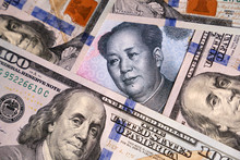 US Dollars And Chinese Yuan Banknote. Concept Of Trade War Between The China And USA, Economic, Sanctions, Tourism And Investment