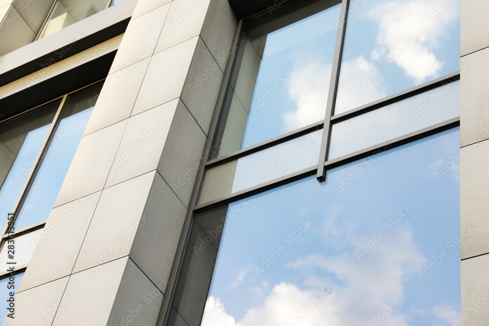 Fototapeta Modern office building with tinted windows. Urban architecture