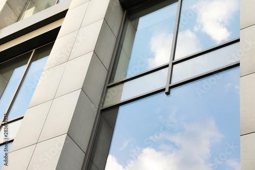 Fototapeta Modern office building with tinted windows. Urban architecture obraz