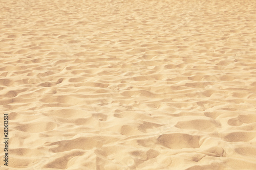 Photo Golden beach sand on sunny day as background