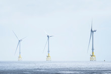 Wind Turbines At Electric Power Farm In The North Sea In Aberdeen For Renewable Energy Production And Environment Conservation