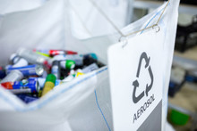 Sorting Recyclables. The Sorted Aerosol Aluminum Cans, Is Placed In A Container With The Appropriate Marking.