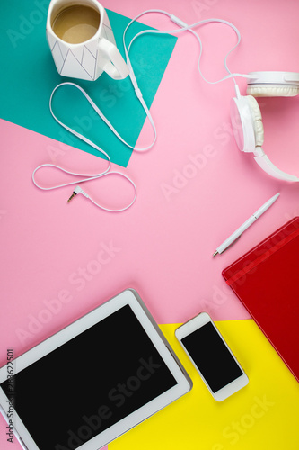 Flat lay of laptop, earphones, digital gadget, modern concept on soft pink background with copy space - 283622501