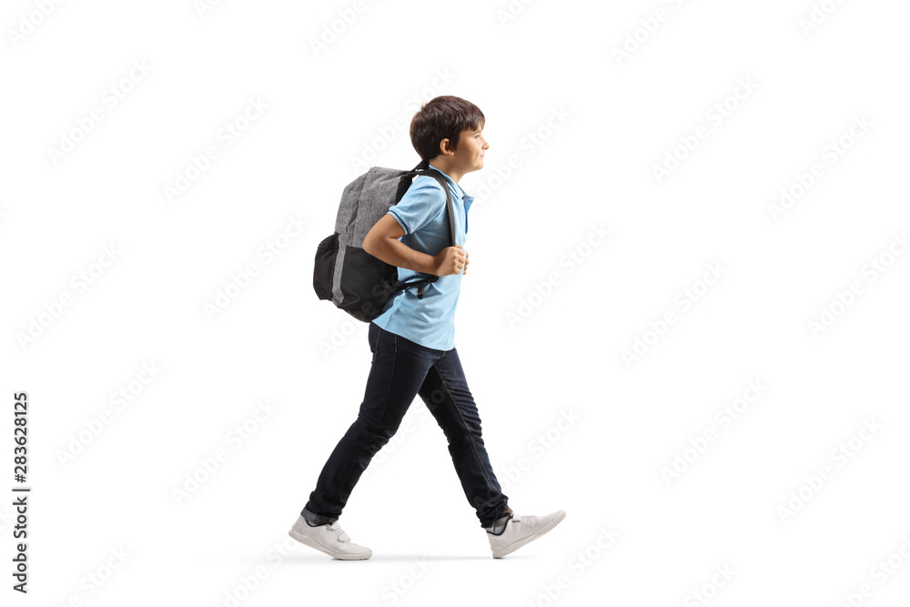 Fototapety, obrazy: Schoolboy with a backpack walking