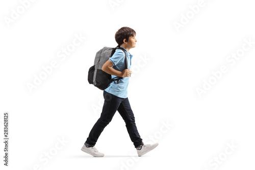 Fototapeta Schoolboy with a backpack walking obraz