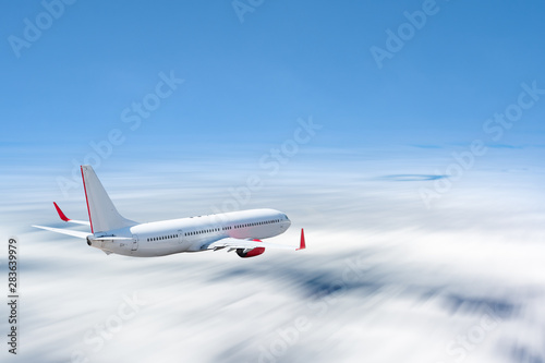 White airplane flying above cloud at daytime with motion blur effect - 283639979