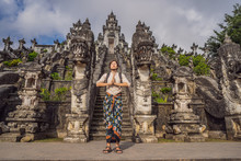 Young Man Tourist On Background OfThree Stone Ladders In Beautiful Pura Lempuyang Luhur Temple. Summer Landscape With Stairs To Temple. Paduraksa Portals Marking Entrance To Middle Sanctum Jaba Tengah