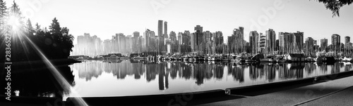 Fototapety, obrazy: Black and white panoramic view of Vancouver skyline at sunrise as seen from Stanley Park, British Columbia, Canada.