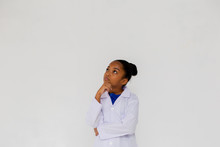 Young Preteen African American Kid Wearing Lab Coat Thinking And Questioning In White Isolated Background