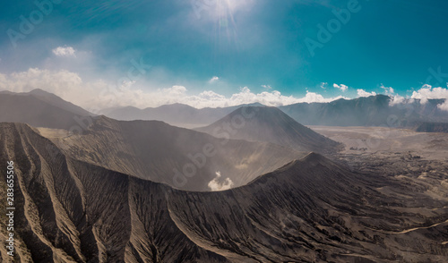 Foto auf Leinwand Grau Verkehrs Cinematic shot aerial view of Mount Bromo crater with active volcano smoke in East Java, Indonesia