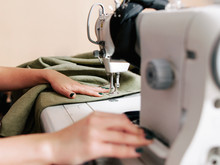 Upholstery Manufacturing. Cropped Shot Of Seamstress Working With Sewing Machine In Tailor Studio.