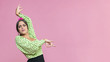 Leinwanddruck Bild - Medium shot flamenca performing floreo on pink background