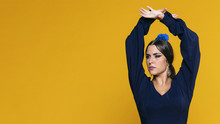 Confident Woman Raising Hands With Copy Space