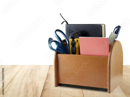 Obraz na plátně  brown plywood desk organizer with office supplies and stationery on wooden table