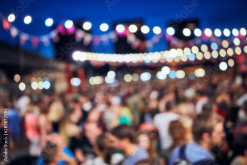 Fototapeta Blurred large group of people with de-focused lights. obraz