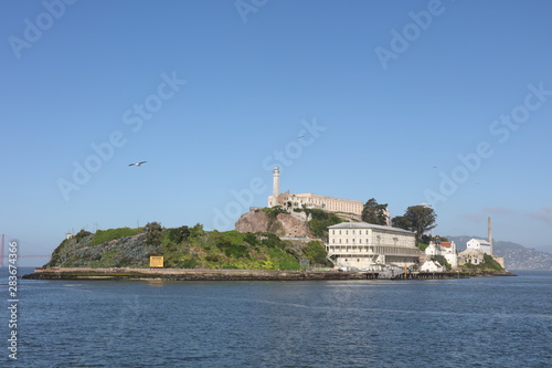 Fotografie, Tablou  Alcatraz Prison Island in San Francisco Bay, offshore from San Francisco, California, a small island with military fortification and federal prison, now a famous national historical landmark