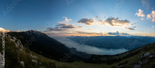 Fotomural 180 degrees panoramic view over lake Garda at sunset hour