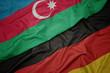 Leinwandbild Motiv waving colorful flag of germany and national flag of azerbaijan.
