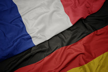 Waving Colorful Flag Of Germany And National Flag Of France.