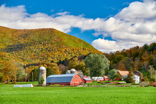 Farm With Red Barn And Silos A...