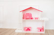 Doll houses in the children's room, furniture for children in the interior of the children's room