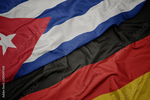 waving colorful flag of germany and national flag of cuba. Wallpaper Mural