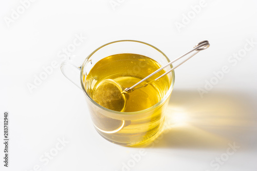 Fotografia, Obraz  A cup of Chamomile tea in a clear glass mug