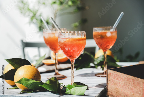 Aperol Spritz aperitif alcohol cocktail in glasses with fresh oranges and ice on grey marble board, selective focus, close-up Canvas Print