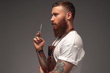 Serious Bearded Stylist With S...