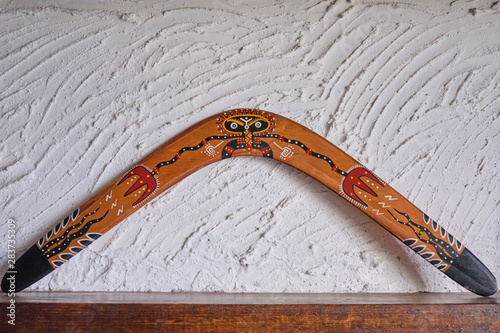 Photo Wooden boomerang close up. The decor of the interior