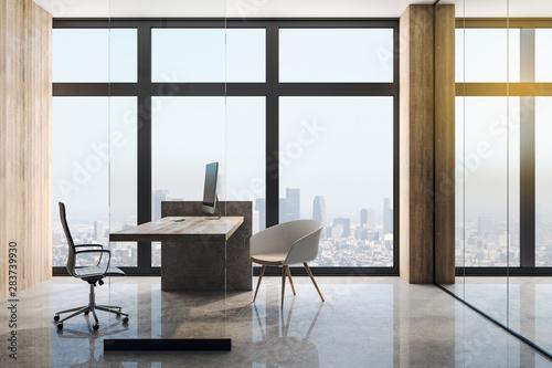 Modern loft style office with big window in skyscraper.
