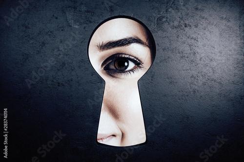 Female eye in keyhole Tablou Canvas