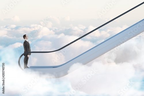 Valokuva  Road to success concept with businessman going up by escalator among white clouds