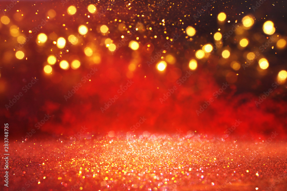 Fototapeta abstract Red glitter lights background. defocused