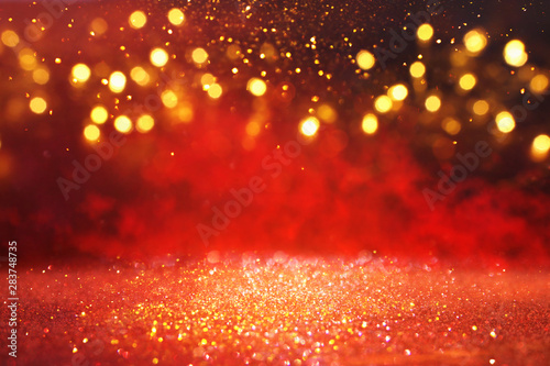 Foto abstract Red glitter lights background. defocused