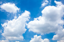 Cloudscape Of Beautiful Big Thick White Fluffy Group Of Clouds In Bright Blue Sky In Sunny Day In Summer. Fresh And Good Air Quality And Climate. Freedom And Calm.