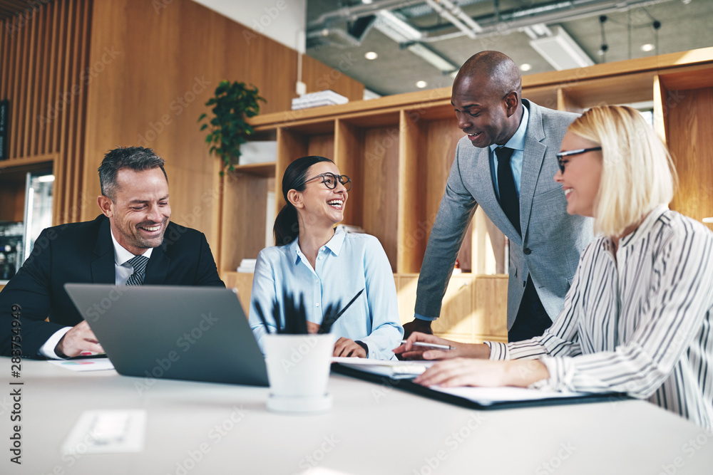 Fototapety, obrazy: Group of diverse businesspeople laughing together during an offi